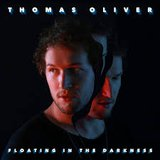 Floating In The Darkness  by Thomas Oliver cover art